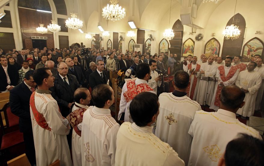 Egyptian Coptic Christians pray during Christmas Mass at St. Marc and the Virgin Mary Coptic Church east of Beirut on Thursday, Jan. 6, 2011, in memory of the 21 Copts killed in a weekend massacre at a church in Alexandria, Egypt. (AP Photo/Bilal Hussein)