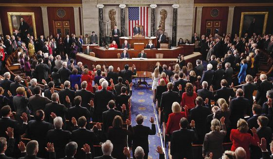 Members of the U.S. House of Representatives take their oath of office during the first session of the 112th Congress on Capitol Hill in Washington on Wednesday, Jan. 5, 2011. (AP Photo/Charles Dharapak) ** FILE **