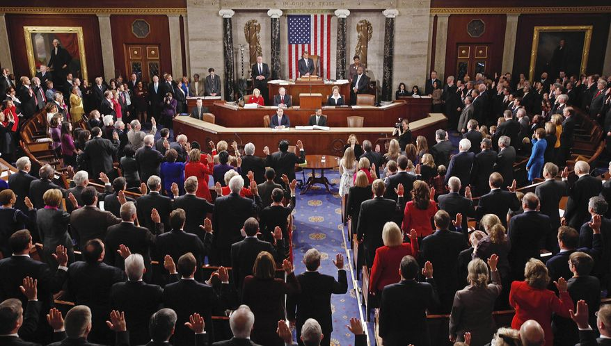 ** FILE ** Members of the U.S. House of Representatives take their oath of office during the first session of the 112th Congress on Capitol Hill in Washington on Wednesday, Jan. 5, 2011. (AP Photo/Charles Dharapak)