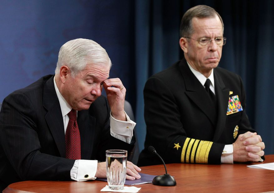 Defense Secretary Robert M. Gates and Joint Chiefs Chairman Adm. Mike Mullen discuss the proposed defense budget, which calls for major personnel cuts, with reporters Thursday at the Pentagon. (Associated Press)