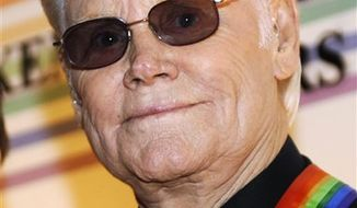 FILE - In this Dec. 7, 2008 file photo, George Jones arrives for the Kennedy Center Honors at the Kennedy Center in Washington. Jones is hospitalized in Nashville. A statement from his publicist, Kirt Webster, says he went in for an annual checkup on Wednesday, Jan. 5, 2011 and doctors required him to stay overnight to continue monitoring him. He is expected to be released Thursday. (AP Photo/Jacquelyn Martin, File)