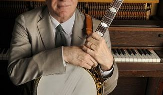 FILE - In this March 19, 2010 file photo, actor, musician and writer Steve Martin poses with his banjo backstage before an appearance with the Steep Canyon Rangers band at Largo at the Coronet Theatre in Los Angeles. (AP Photo/Chris Pizzello, file)