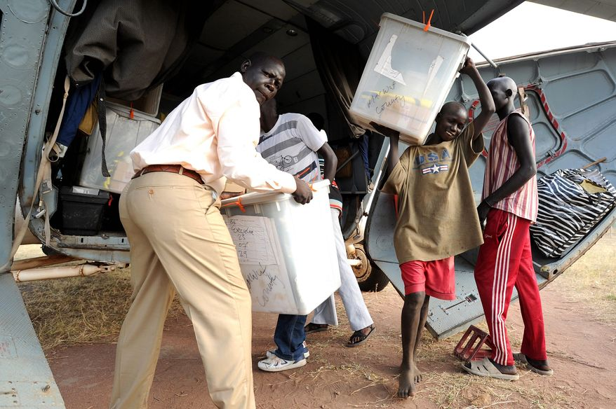 Citizens unloaded voting material at Tali, in southern Sudan, earlier this week. Referendum voting begins Sunday to determine whether south Sudan should remain part of the country or to break away from the north. (Associated Press)