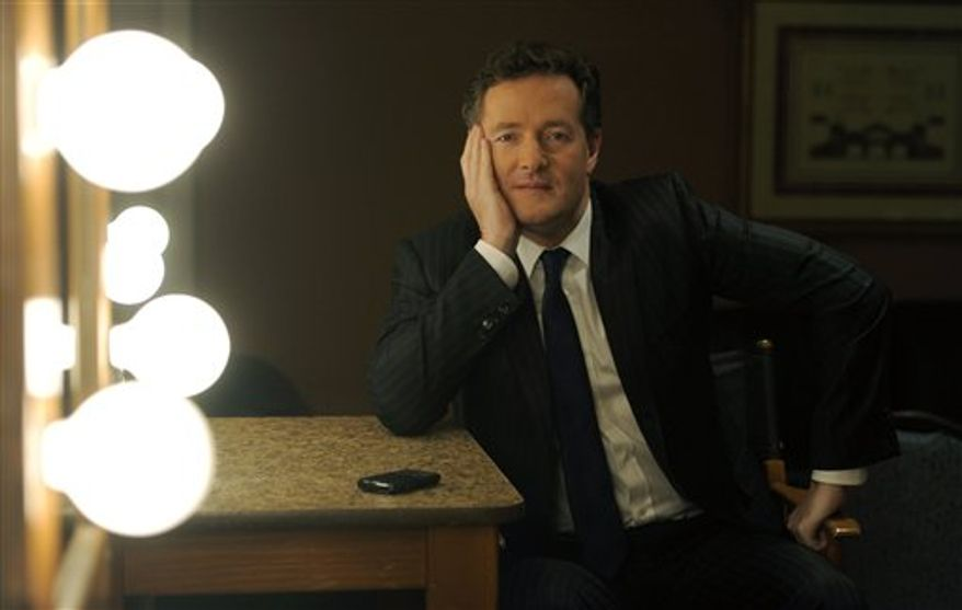 "Piers Morgan, host of CNN's new interview show ""Piers Morgan Tonight,"" poses for a portrait backstage during the Turner Broadcasting Television Critics Association winter press tour in Pasadena, Calif., Thursday, Jan. 6, 2011. (AP Photo/Chris Pizzello)"