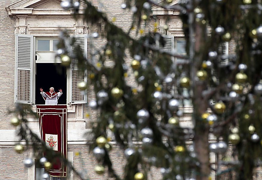 """Pope Benedict XVI, framed by a Christmas tree, delivers his blessing from his studio window overlooking St. Peter's Square following an Epiphany Mass at the Vatican on Thursday, Jan. 6, 2011. Benedict XVI is stunned by the wave of violence and intolerance toward Christians around the world, Italy's top churchman said Thursday at Epiphany services. """"Together with the Holy Father, Benedict XVI, we are stunned in the face of religious intolerance and so much violence, and we are asking ourselves, in sorrow: Why?'' said Cardinal Angelo Bagnasco, president of Italy's bishops conference in an Epiphany homily in Genoa. Benedict told pilgrims and tourists he was offering heartfelt greeting and wishes to """"the brothers and sisters of the Eastern churches who tomorrow will celebrate Holy Christmas.'' (AP Photo/Pier Paolo Cito)"""