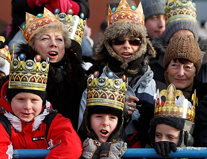 Residents of Warsaw, wearing colorful paper crowns, watch the Epiphany parade through the city on Thursday, Jan. 6, 2011. Poland observed Epiphany as an official public holiday for the first time in 50 years. The Epiphany feast day celebrates the visit of the three kings to the infant Jesus. (AP Photo/Czarek Sokolowski)