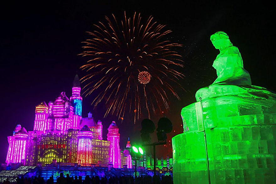 In this Wednesday, Jan. 5, 2011 photo, fireworks explode above giant ice sculptures during the opening ceremony of the annual Harbin Ice and Snow Festival in Harbin in northeast China's Heilongjiang province. (AP Photo)