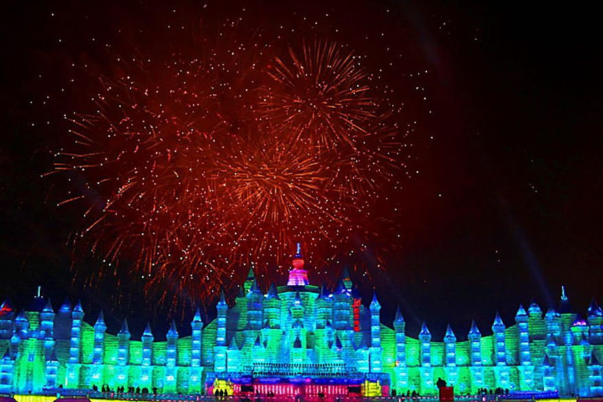 Fireworks explode above ice sculptures during the opening ceremony of the annual Harbin Ice and Snow Festival in Harbin in northeast China's Heilongjiang province on Wednesday, Jan. 5, 2011. (AP Photo)