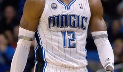 Milwaukee Bucks' Earl Boykins (11) looks to pass the ball as he is guarded by Orlando Magic's Gilbert Arenas (1) during the first half of an NBA basketball game in Orlando, Fla., Tuesday, April 5, 2011. (AP Photo/John Raoux)