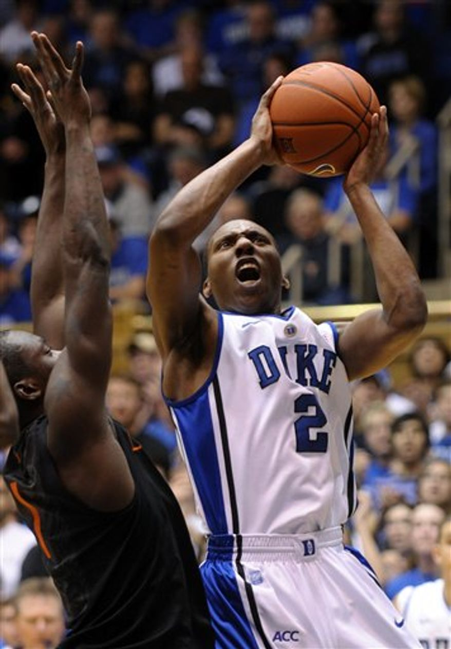 Duke's Nolan Smith (2) drives to the basket past Miami's Durand Scott (1) during the first half an NCAA college basketball game in Durham, N.C., Sunday, Jan. 2, 2011. Duke won 74-63 over Miami. (AP Photo/Sara D. Davis)