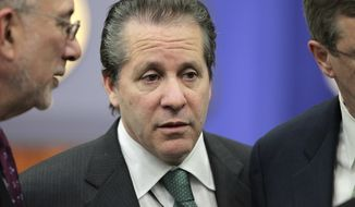 ** FILE ** Gene Sperling, counselor to Treasury Secretary Timothy F. Geithner, arrives for the tax cut extension bill to be signed by President Obama during a ceremony at the Eisenhower Executive Office Building in the White House complex in Washington on Dec. 17, 2010. Mr. Obama was set to name Mr. Sperling director of the National Economic Council on Friday, Jan. 7, 2011. (AP Photo/J. Scott Applewhite)