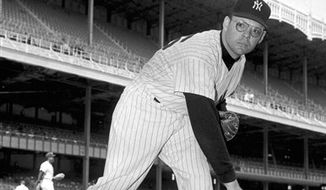 FILE - In this April 30, 1958 file photo, New York Yankees pitcher Ryne Duren is shown in a posed action at Yankee Stadium in New York. Duren, an All-Star pitcher known for a 100 mph fastball, occasional wildness and thick glasses that created an intimidating presence of the pitcher's mound, died Thursday, Jan. 6, 2011 at his winter home in Florida, his stepson Mark Jackson said. (AP Photo/File)