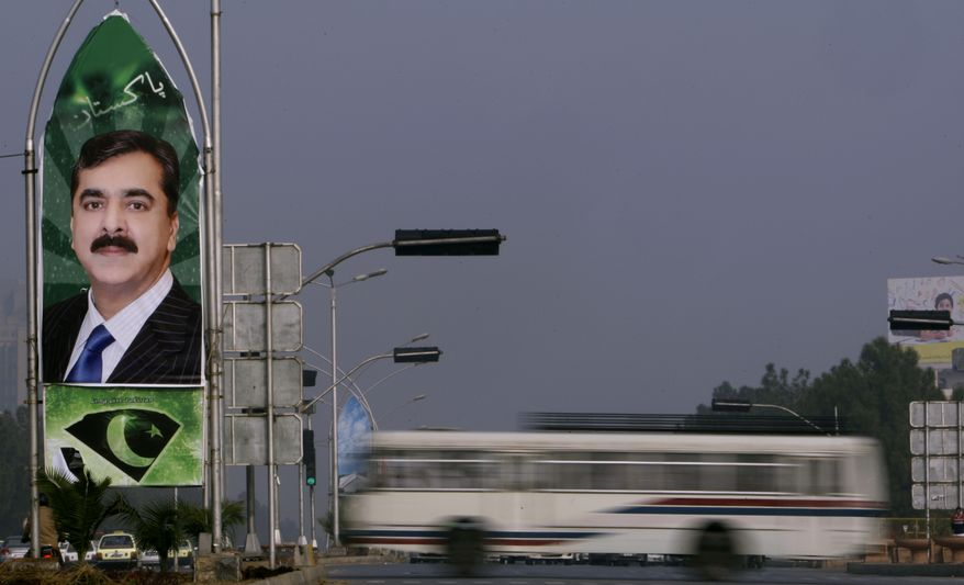 A billboard showing Pakistani Prime Minister Yousuf Raza Gilani is seen in Islamabad, Pakistan, Tuesday, Jan. 4, 2011. The second-largest member of Pakistan's ruling coalition reversed its decision to join the opposition Friday, Jan. 7, after the government backed down on unpopular economic measures. (AP Photo/Muhammed Muheisen)