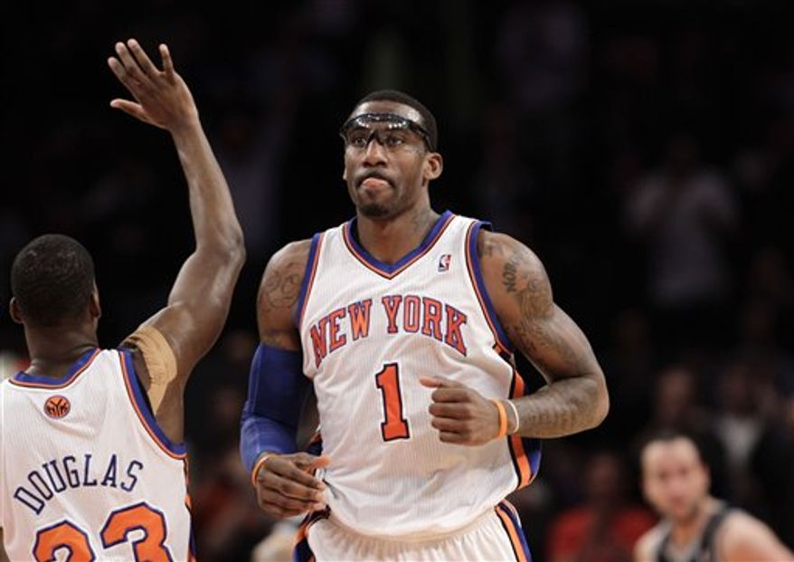 New York Knicks forward Amare Stoudemire (1) drives toward the basket with San Antonio Spurs DeJuan Blair (45) defending in the first quarter of their NBA basketball game at Madison Square Garden  in New York, Tuesday, Jan. 4, 2011.  (AP Photo/Kathy Willens)