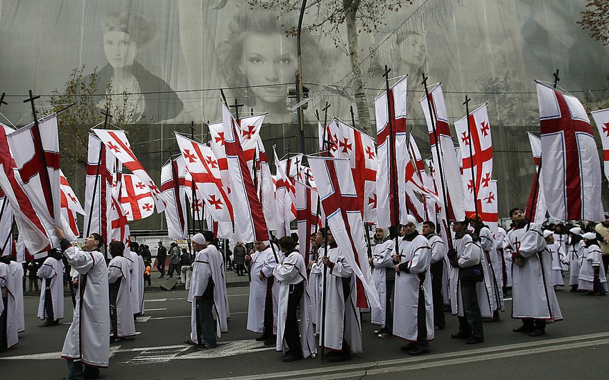 People take part in a religious procession to mark the Orthodox Christmas in Tbilisi, Georgia, on Friday, Jan. 7, 2011. Georgians celebrate Christmas on January 7, according to the Julian calendar used by the country's Orthodox church. (AP Photo/Shakh Aivazov)