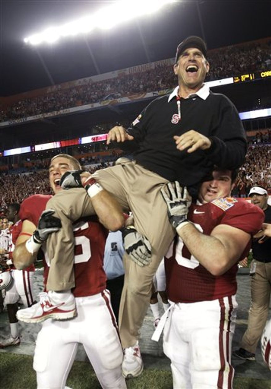Stanford coach Jim Harbaugh is lifted by players after Stanford's 40-12 victory over Virginia Tech in the Orange Bowl NCAA college football game, Monday, Jan. 3, 2011, in Miami. (AP Photo/Lynne Sladky)