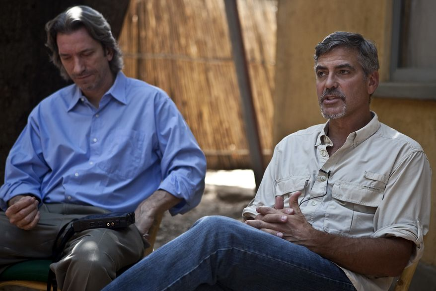 Actor and activist George Clooney conducts an interview in the southern Sudanese capital city of Juba on Saturday, Jan. 8, 2011. He is flanked by John Prendergast, left, an American analyst of African conflicts and the director of the ENOUGH campaign. Clooney is visiting southern Sudan in a bid to draw attention to the situation as southern Sudanese prepare to vote in an independence referendum that will determine whether the region secedes from the north to form the world's newest country. Seven days of voting in the referendum is set to commence Sunday morning. (AP Photo/Pete Muller)