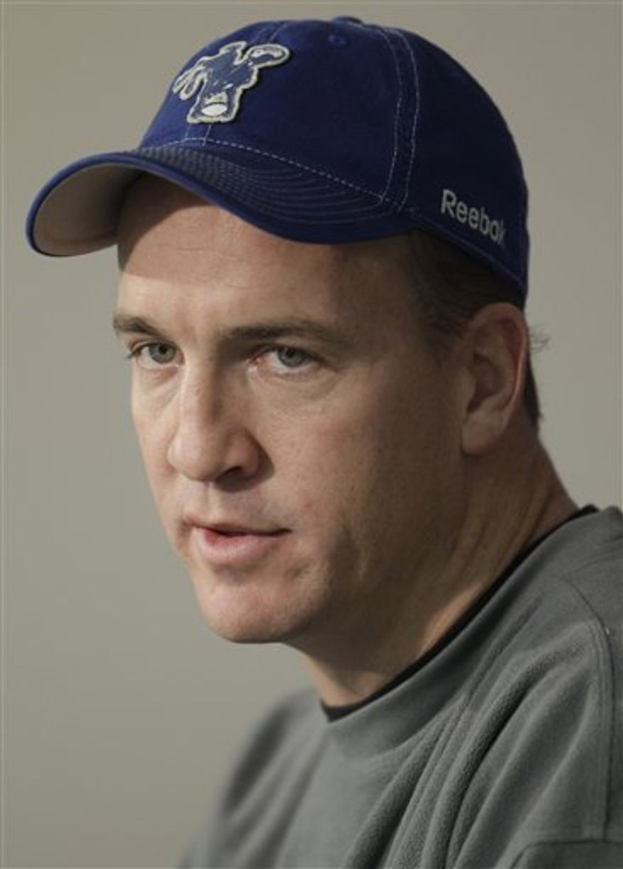 Indianapolis Colts quarterback Peyton Manning responds to a question during a news conference in Indianapolis, Tuesday, Jan. 4, 2011. The Colts are scheduled to host the New York Jets in a playoff game on Saturday, Jan. 8. (AP Photo/Darron Cummings)