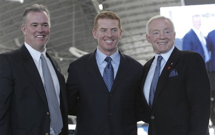 Dallas Cowboys head fooball coach Jason Garrett smiles as he speaks to reporters after an NFL football news conference at Cowboys Stadium in Arlington, Texas, Thursday, Jan. 6, 2011.  Garrett was officially named head coach. (AP Photo/LM Otero)