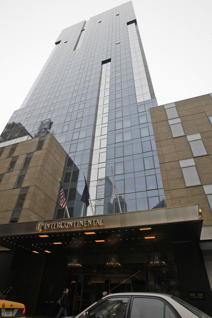 The InterContinental hotel is shown on Saturday, Jan. 8, 2011, in New York. Carlos Castro, a 65-year-old Portuguese television journalist, was found castrated and bludgeoned to death in the hotel, and his companion, a male model who had recently been a contestant on a Portuguese reality TV show, was in police custody Saturday. Workers at the hotel discovered the mutilated body at about 7 p.m. Friday after a friend of Castro became worried. (AP Photo/Frank Franklin II)