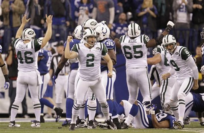 Indianapolis Colts quarterback Peyton Manning (18) throws a pass during the first quarter of an NFL AFC wild card football playoff game against the New York Jets in Indianapolis, Saturday, Jan. 8, 2011. (AP Photo/Nam Y. Huh)