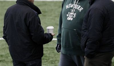 New York Jets owner Woody Johnson, left, chats with coach Rex Ryan, center, and general manager Mike Tannenbaum, right, during NFL Football practice, Tuesday, Jan. 4, 2011, in Florham Park, N.J. The Jets are scheduled to play the Indianapolis Colts in a playoff game on Saturday, Jan. 8 in Indianapolis. (AP Photo/Mel Evans)