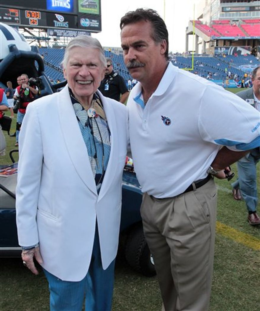 "FILE - In this Sept. 2, 2010, file photo, Tennessee Titans coach Jeff Fisher, right, talks with Titans owner Bud Adams prior to an NFL preseason football game against the New Orleans Saints at LP Field in Nashville, Tenn. Coaches rarely win ""him-or-me"" arguments when the team's star is involved. But Tennessee's Jeff Fisher did when Titans owner Bud Adams showed quarterback Vince Young the door. (AP Photo/Dave Martin, File)"