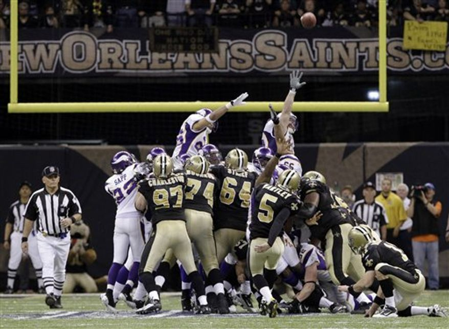 FILE - In this Jan. 24, 2010, file photo, New Orleans Saints kicker Garrett Hartley (5) kicks the game-winning field goal during overtime in the NFC Championship NFL football game against the Minnesota Vikings in New Orleans. When the NFL playoffs begin this weekend, they will feature a new rule for overtime. The tweak was made last March, two months after Garrett Hartley's field goal won the NFL championship game. (AP Photo/Mark Humphrey, File)