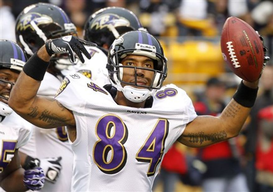 FILE - In this Oct. 3, 2010, file photo, Baltimore Ravens wide receiver T.J. Houshmandzadeh (84) celebrates making a touchdown catch with less than a minute to go in the NFL football game, giving the Ravens the lead over the Pittsburgh Steelers in Pittsburgh. This is the time of year when Houshmandzadeh usually plunks himself in front of the television to watch the NFL playoffs. On Sunday, he hopes to put on a show everyone else can enjoy. (AP Photo/Keith Srakocic, File)