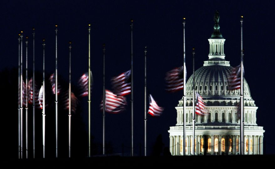 MOURNING: Flags in Washington were lowered to half-staff by order of President Obama to remember the victims of the rampage. (Associated Press)