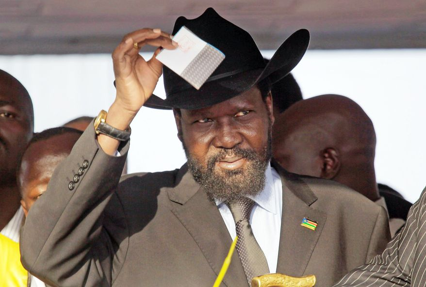 Salva Kiir, president of the semiautonomous government of Southern Sudan, casts his vote in front of a cheering crowd of hundreds of Sudanese voters in Juba on Sunday. (Associated Press)