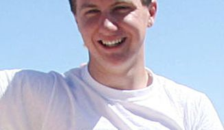 This March 2010 photo shows a man identified as Jared Loughner at the 2010 Tucson Festival of Books in Tucson, Ariz. The Arizona Daily Star, a festival sponsor, confirmed from their records that the subject's address matches one under investigation by police after a shooting in Tucson that left Rep. Gabrielle Giffords wounded and six others dead. Police say a suspect is in custody, and he was identified by people familiar with the investigation as Mr. Loughner, 22, of Tucson. (AP Photo/Arizona Daily Star, Mamta Popat)