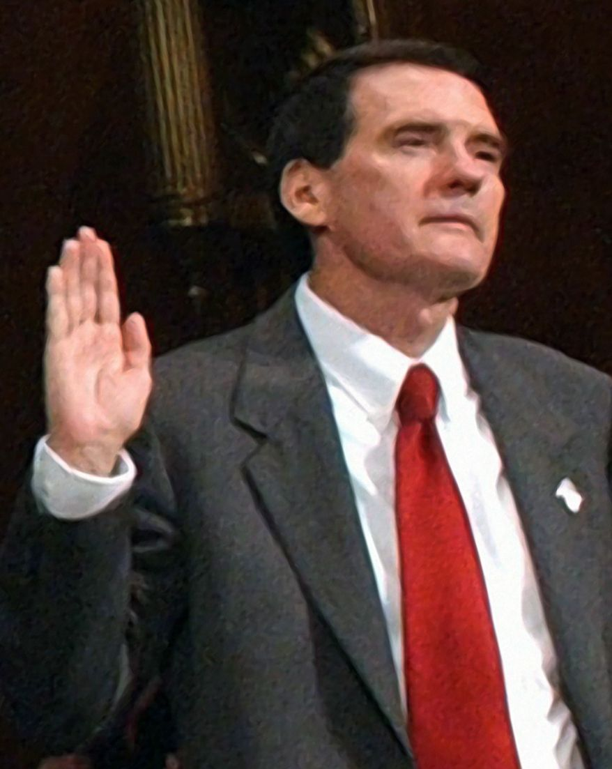 ** FILE ** U.S. District Judge John M. Roll appears before the Senate Judiciary Committee on Capitol Hill in April 2006 to discuss immigration litigation reduction. (AP Photo/Dennis Cook, File)