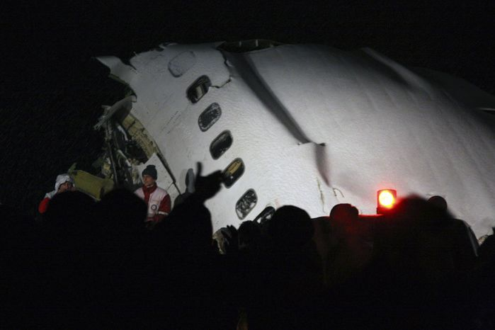 In this picture released by the Mehr news agency, wreckage of a IranAir Boeing 727 passenger plane that crashed Sunday after making an emergency landing is seen outside the city of Orumiyeh, 460 miles northwest of Tehran. An IranAir passenger jet carrying 106 people crashed as it was making an emergency landing Sunday in a snowstorm in the country's northwest and broke into several pieces, killing more than 70 of those on board, Iranian media reported. The others survived with light injuries. (Associated Press/Mehr News Agency, Esfandiar Asgharkhani)