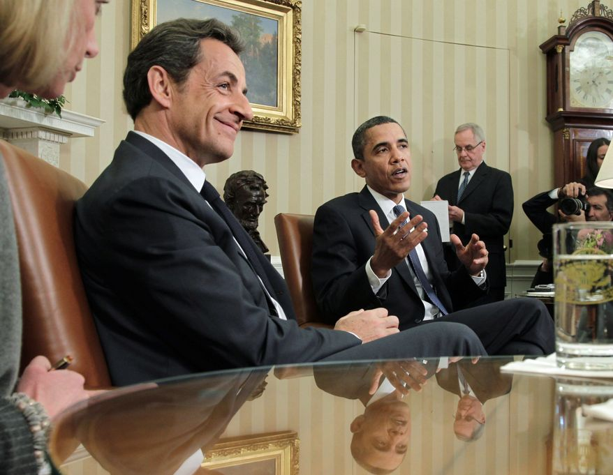 """President Obama confers Monday with visiting French President Nicolas Sarkozy. """"There's still too many imbalances in the world economy that are inhibiting the prospects of growth,"""" Mr. Sarkozy said. (Associated Press)"""