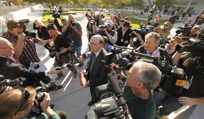 U.S. District Attorney Patrick Cunningham (center) talks to the press after the initial court appearance of Jared Loughner in Phoenix on Monday. (Associated Press)