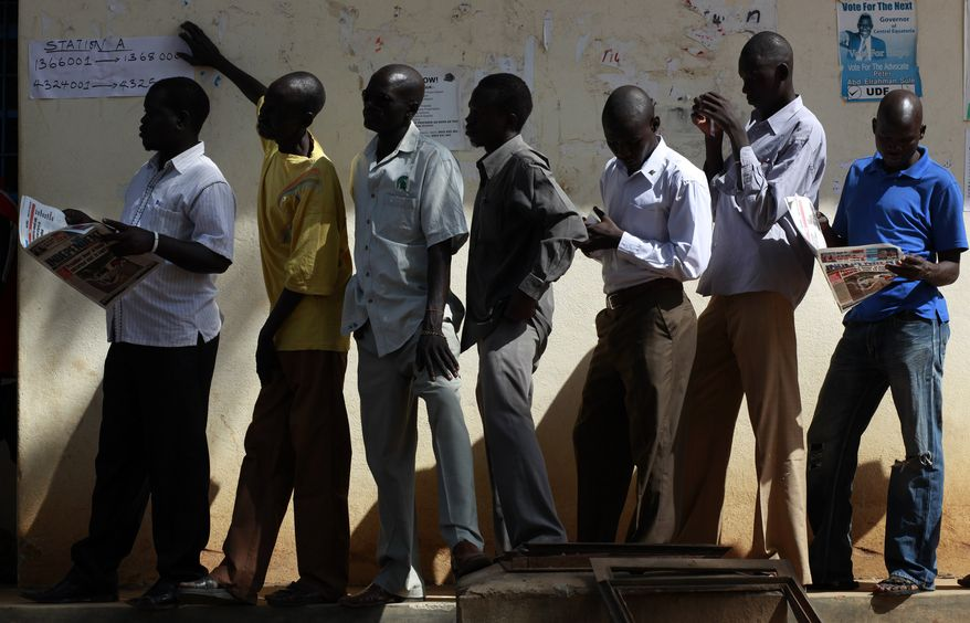 South Sudanese men wait to casts their vote at a polling station in Juba, Southern Sudan, Monday, Jan 10, 2011. Thousands of people began casting ballots Sunday during a weeklong vote to choose the destiny of this war-ravaged and desperately poor but oil-rich region. The mainly Christian south is widely expected to secede from the mainly Muslim north, splitting Africa's largest country in two.(AP Photo/Jerome Delay)
