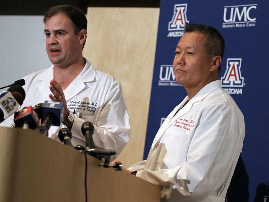 Dr. G. Michael Lemole Jr. (left) speaks about the condition of Rep. Gabrielle Giffords as Dr. Peter Rhee looks on during a news conference at the University Medical Center in Tucson, Ariz., on Sunday, Jan. 9, 2011. (AP Photo/Chris Carlson)