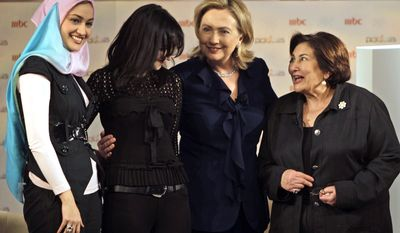 "Secretary of State Hillary Rodham Clinton, 2nd right, poses for the camera after a live show called ""Sweet Talks"", with unidentified Middle East women at Zayed University in Abu Dhabi, United Arab Emirates, Monday Jan.10, 2011. (AP Photo/Kamran Jebreili)"