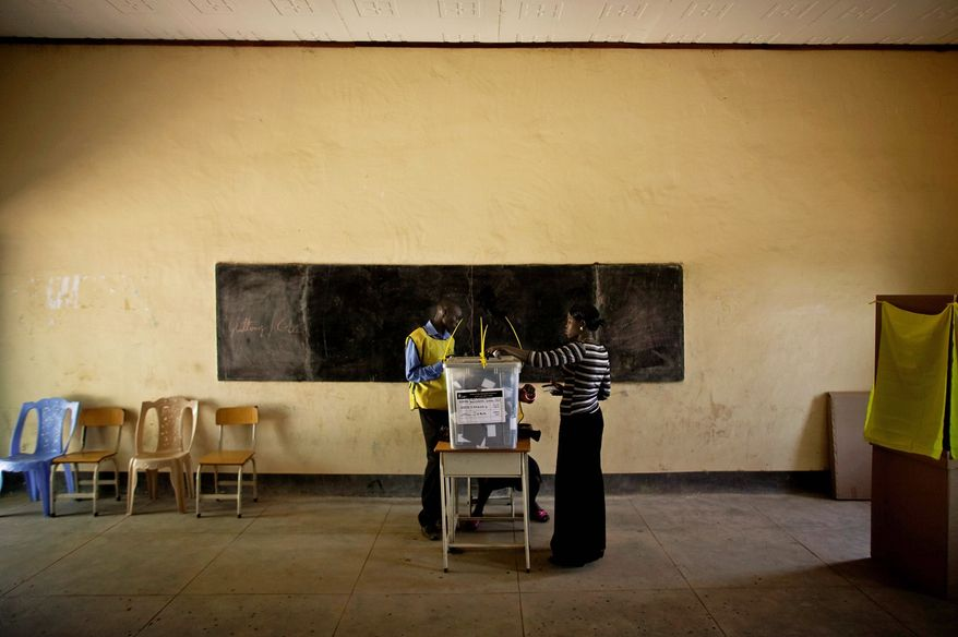 A Southern Sudanese woman casts her vote at a polling center in Juba, Sudan, on Monday, Jan. 10, 2011. Thousands of people began casting ballots Sunday during a weeklong vote to choose the destiny of this war-ravaged and desperately poor but oil-rich region. (AP Photo)