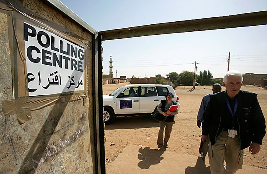 Unidentified observers of the European Union Election Observation Mission for the Southern Sudan referendum arrive at a polling center in the city of Um Durman, Sudan, on Monday, Jan. 10, 2011. Southern Sudan's  military spokesman says 20 policemen in the disputed north-south region of Abyei have been killed and 30 more wounded in two attacks by Arab tribesmen and militia. (AP Photo/Abd Raouf)