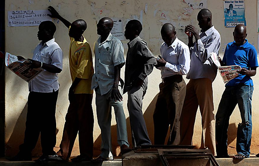 ** FILE ** South Sudanese men wait to casts their vote at a polling station in Juba, Southern Sudan, on Monday, Jan. 10, 2011. Thousands of people began casting ballots day before during a weeklong vote to choose the destiny of this war-ravaged and desperately poor but oil-rich region. (AP Photo/Jerome Delay)