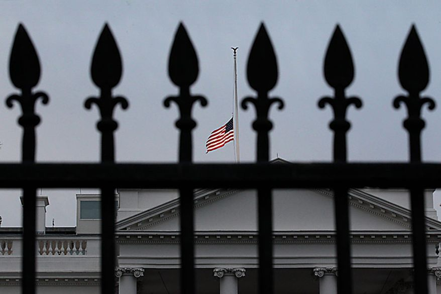 As ordered by President Obama, the American flag flies at half-staff over the White House at dawn, in Washington, Monday. Jan. 10, 2011, in observance of Rep. Gabrielle Giffords, Arizona Democrat, and the other victims of an assassination attempt against her in Saturday's shooting outside a Tucson, Ariz., supermarket. Mrs. Giffords, 40, remained in intensive care at a Tucson hospital after being shot in the head at close range. Among those killed were Arizona's chief federal judge, a 9-year-old girl interested in government, and one of Giffords' aides. (AP Photo/J. Scott Applewhite)