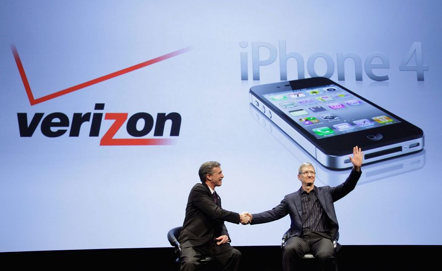 Dan Mead (left) of Verizon Wireless and Tim Cook of Apple announce that Verizon Wireless will start selling Apple's iPhone next month. (Associated Press)
