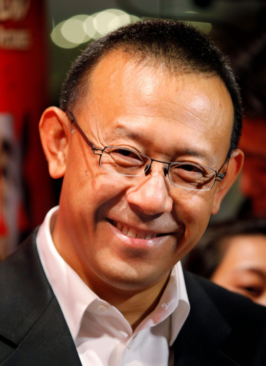 """Jiang Wen is the creative force behind the satire """"Let the Bullets Fly."""" The story is about a Robin Hood-like bandit who kidnaps a con man. (Associated Press)"""