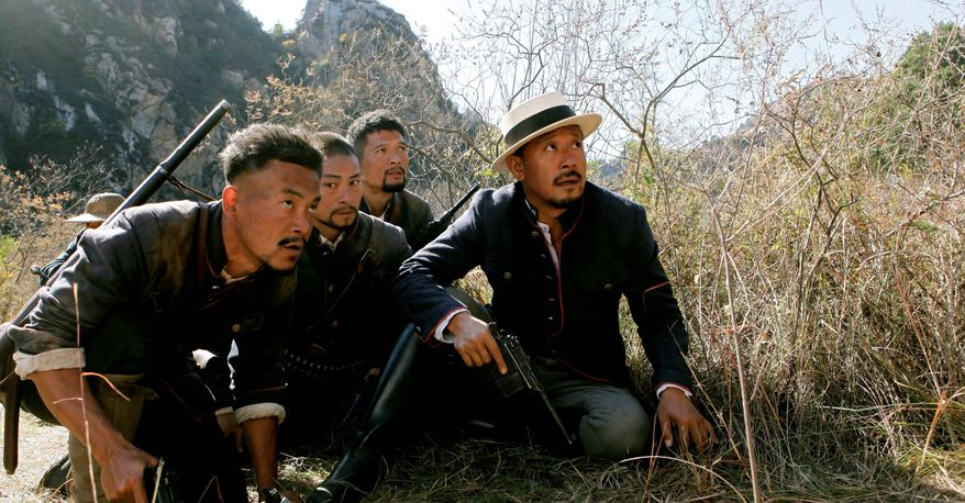 """Chinese actor and director Jiang Wen (right) appears in the movie """"Let the Bullets Fly."""" He has produced one of the year's biggest hits in a sensitive genre, taking in $91 million with a rare political satire in an industry that's still carefully censored by the country's communist government. (Associated Press)"""