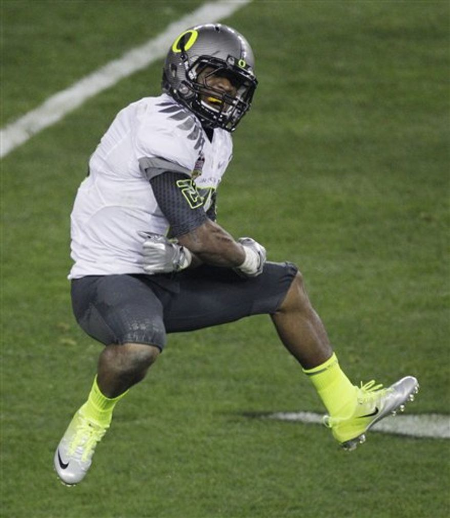 Oregon's LaMichael James (21) reacts after scoring a touchdown during the first half of the BCS National Championship NCAA college football game against Auburn, Monday, Jan. 10, 2011, in Glendale, Ariz. (AP Photo/Charlie Riedel)