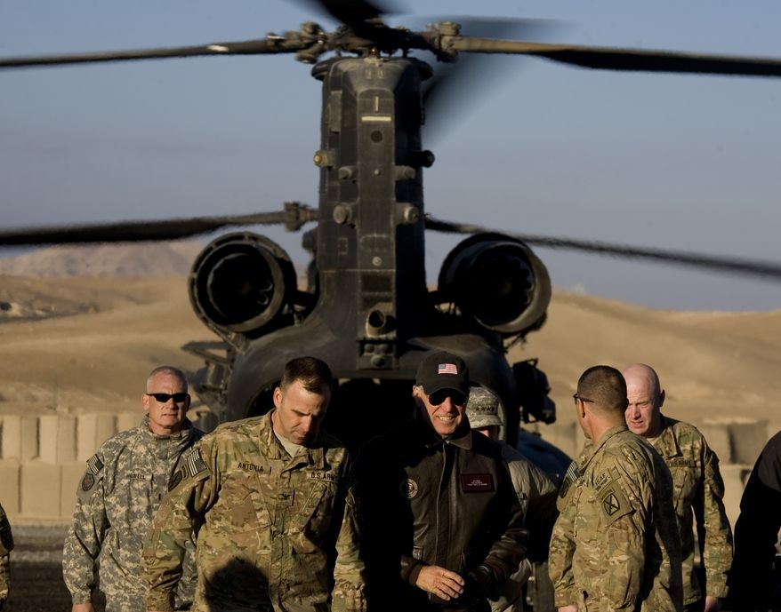 Vice President Joseph R. Biden Jr., center, alights from a helicopter as he arrives at a forward operating base Airborne, in Maidan Shar, in Afghanistan's Wardak province, Tuesday, Jan. 11, 2011. (AP Photo/Dusan Vranic)