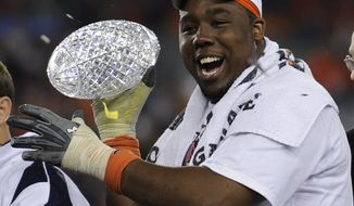 Auburn's Nick Fairley celebrates with the Coaches' Trophy after beating Oregon 22-19 in he BCS National Championship NCAA college football game Monday, Jan. 10, 2011, in Glendale, Ariz. (AP Photo/Mark J. Terrill)