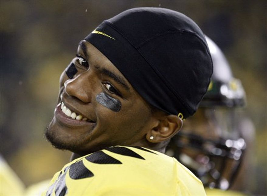 "FILE - In this Oct. 21, 2010, file photo, Oregon's quarterback Darron Thomas smiles during an NCAA college football game against UCLA, in Eugene, Ore. Before the season started, Thomas was the ""other quarterback"" for Oregon. So being the other quarterback in the national championship game doesn't faze him. Just as he did in fall camp, Thomas is going to let his play speak for him. (AP Photo/Rick Bowmer, File)"